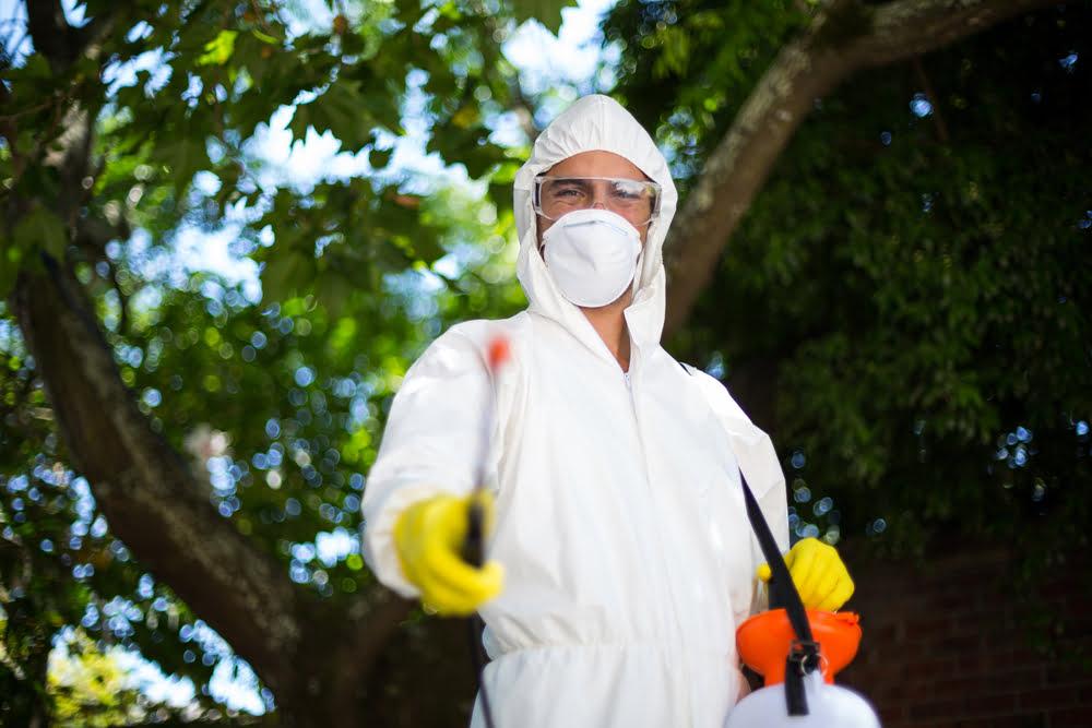 man pointing sprayer
